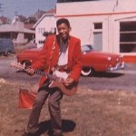 jimi hendrix with a red danelectro