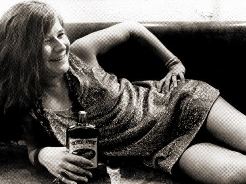 janis joplin with a bottle of whisky upskirt