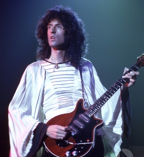 young brian may from queen with his special guitar