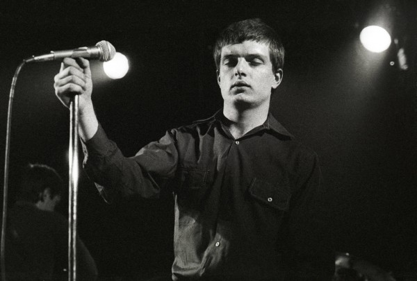 ian curtis eyes closed live on stage